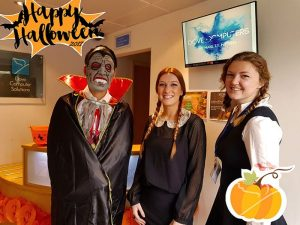 Dove Computers' Team Members; Yi, Beth and Chloe in their Halloween costumes